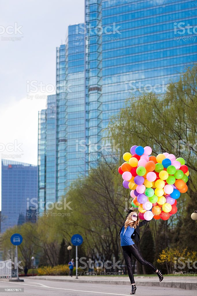 Woman holding many balloons royalty-free stock photo