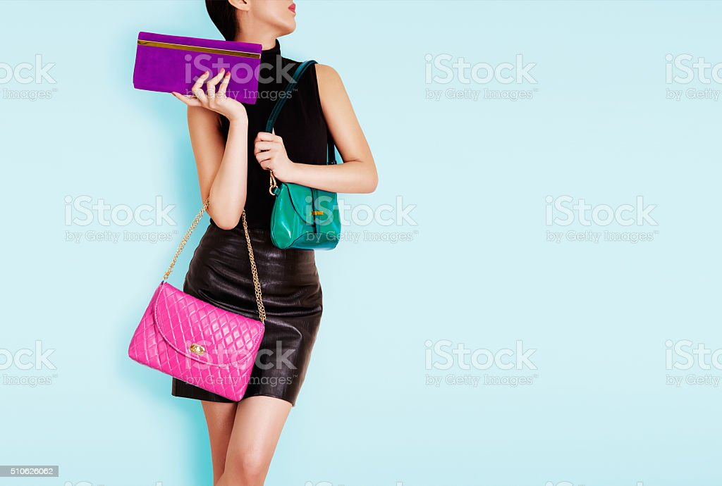Woman holding many colorful bags. Shopping. Fashion image. stock photo
