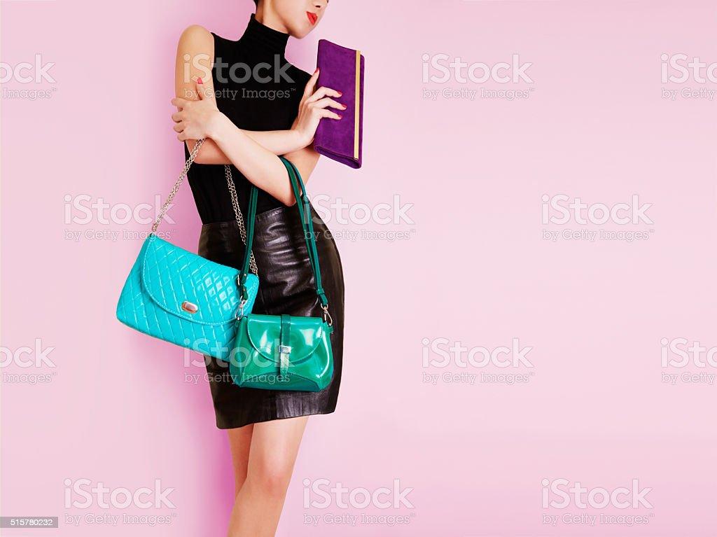 Woman holding many colorful bags. Shopping. Fashion image. stock photo