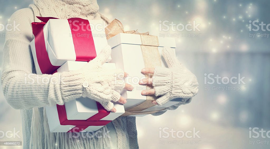 Woman holding many present boxes stock photo