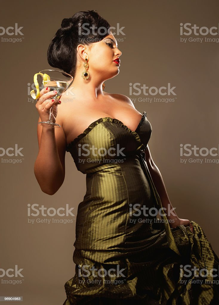 Woman Holding Martini Glass and Wearing Evening Gown royalty-free stock photo