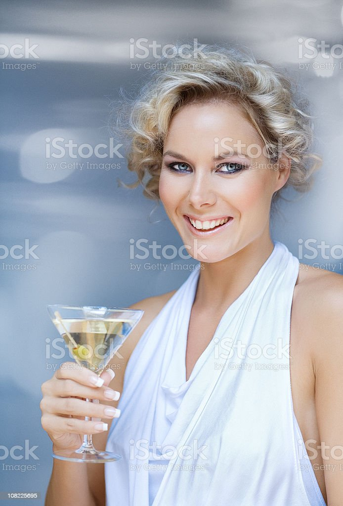 Woman holding martining glass royalty-free stock photo