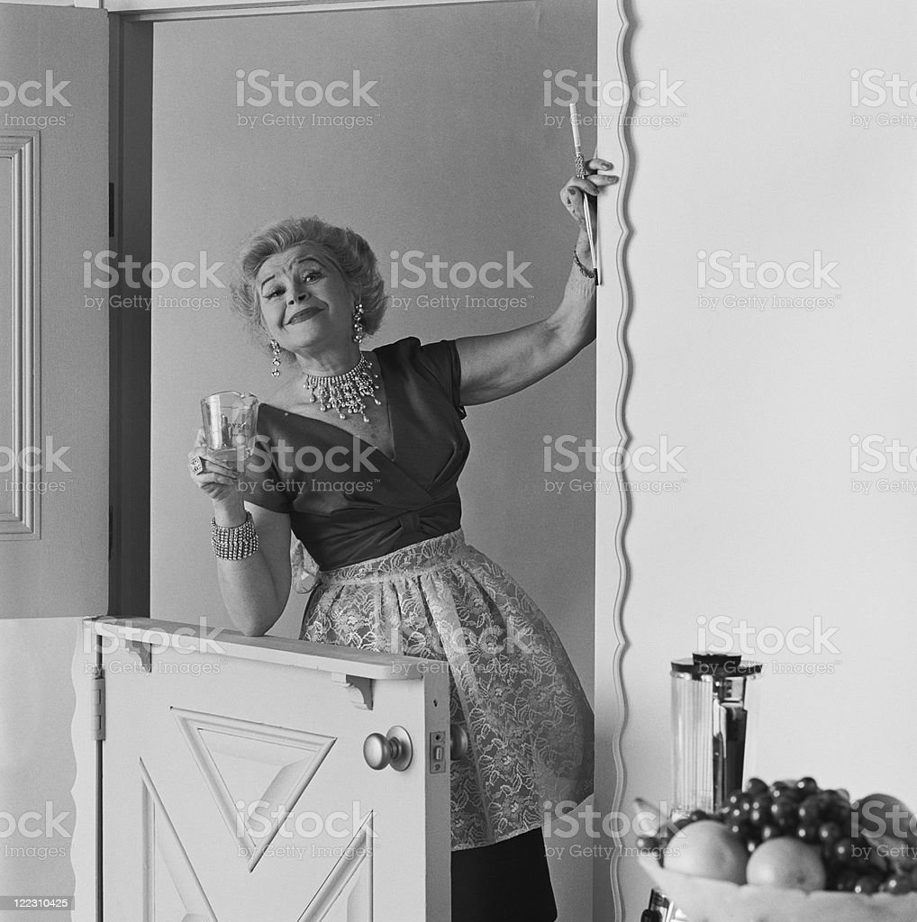 Woman holding measuring cup, portrait stock photo
