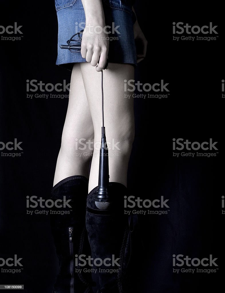 Woman Holding Microphone royalty-free stock photo