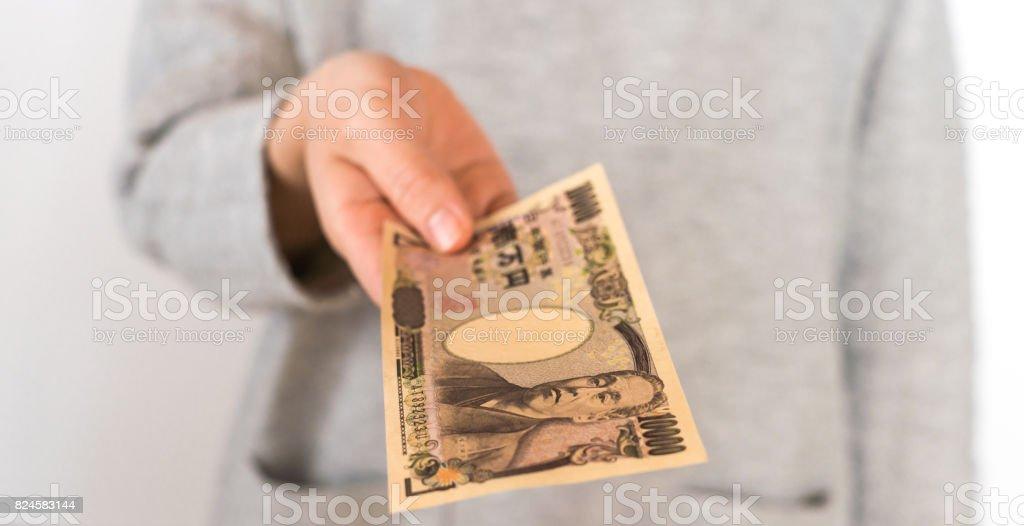 Woman holding money stock photo