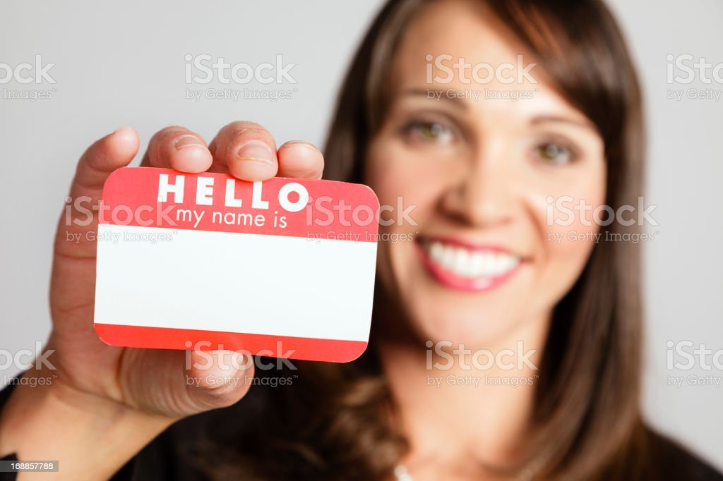 Woman Holding Nametag stock photo