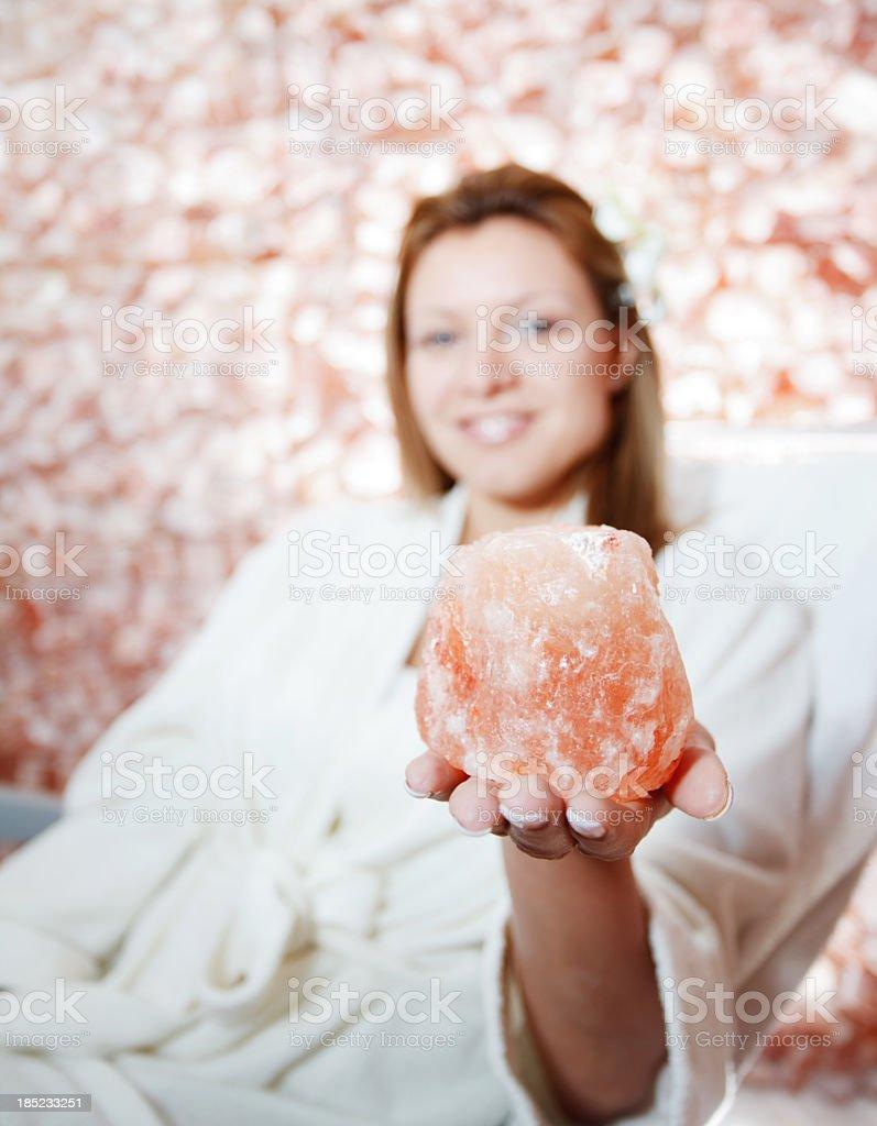 Woman holding natural rock salt. stock photo