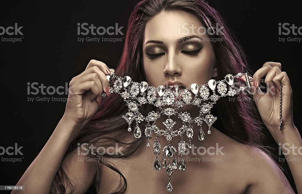woman holding necklace royalty-free stock photo