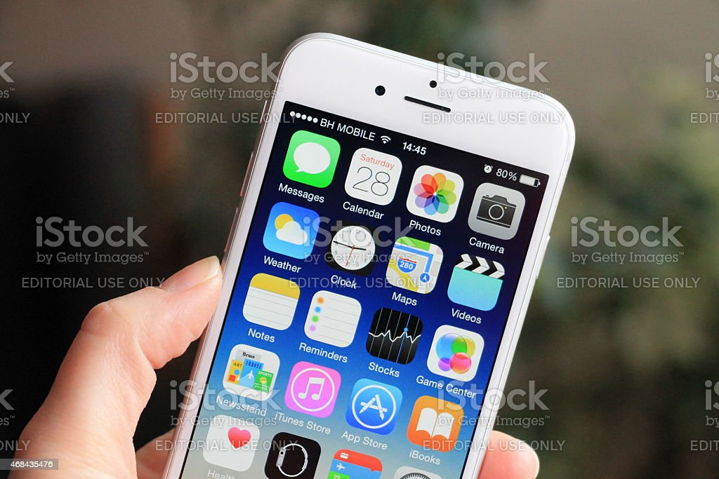 Woman holding new iPhone 6 stock photo