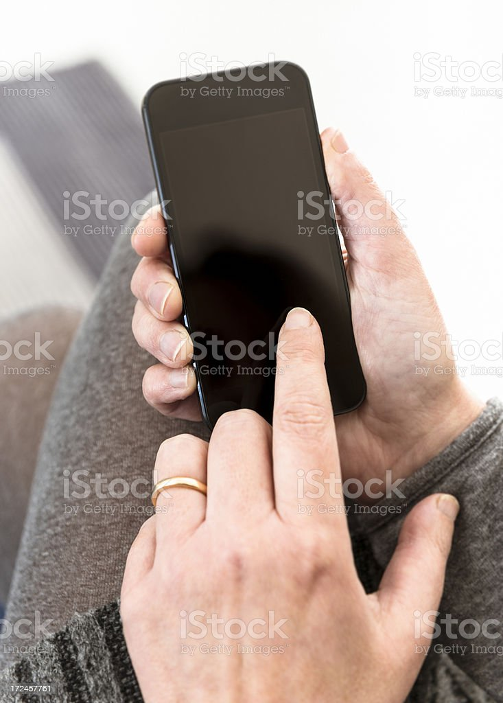 Woman holding new smart phone royalty-free stock photo