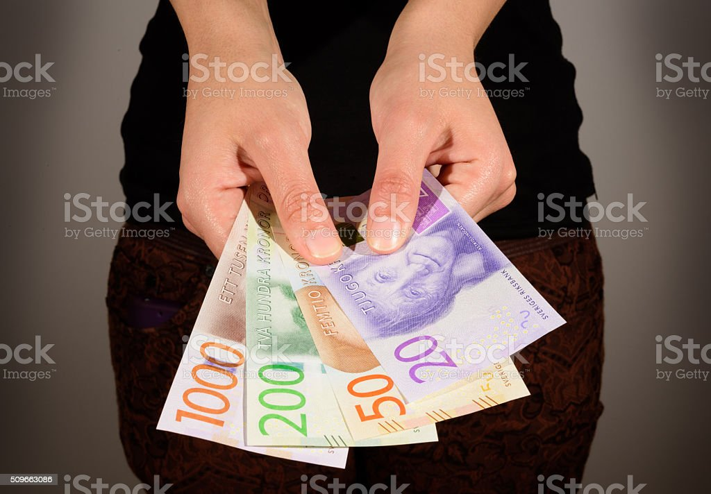 Woman holding new swedish bank notes. NOTE:new 2015 model. stock photo