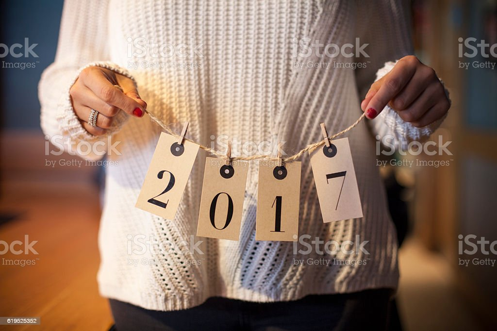 Woman holding new year number cards stock photo