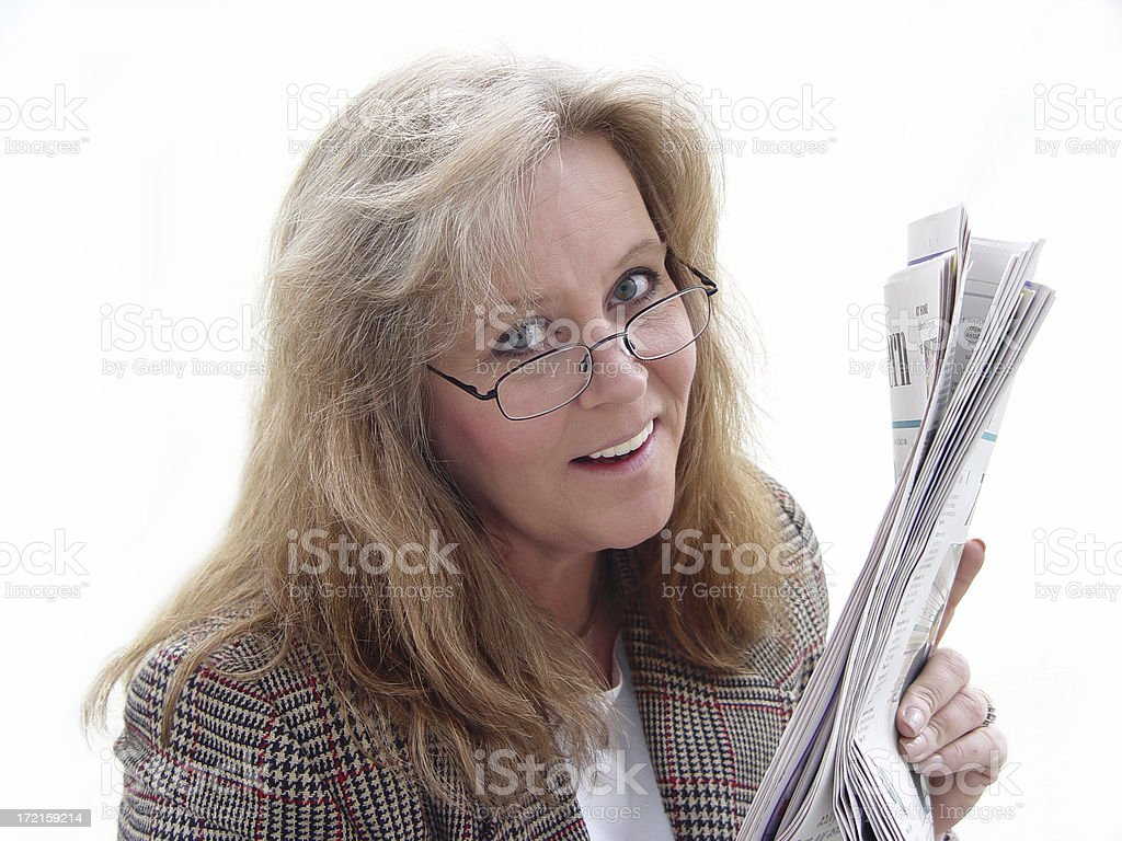 Woman holding newspaper royalty-free stock photo