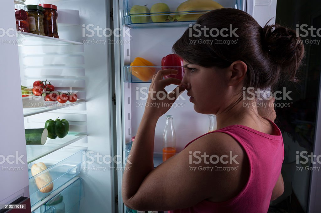 Woman holding nose stock photo