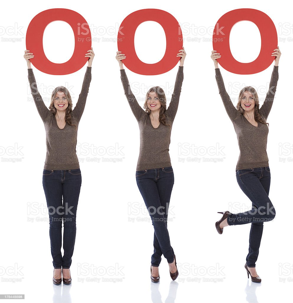 Woman holding number 0. stock photo