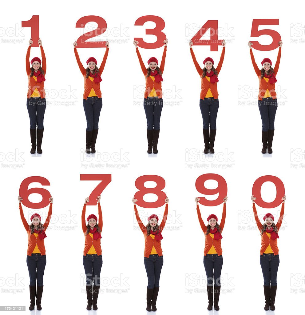 Woman holding numbers. royalty-free stock photo