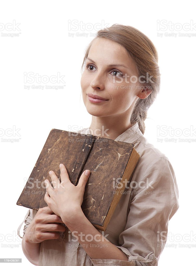 woman holding old book, isolated royalty-free stock photo