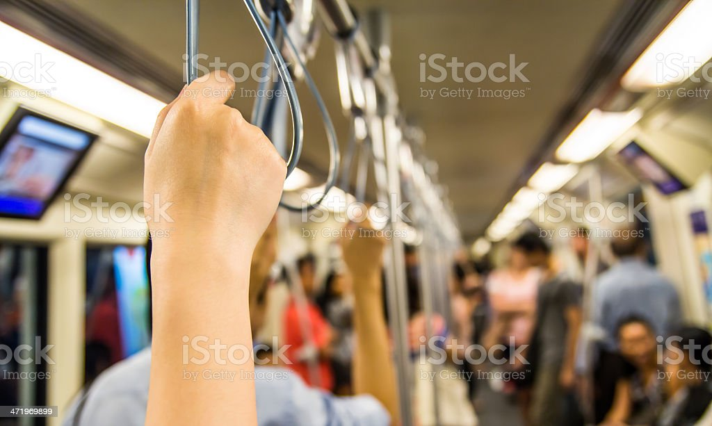 Woman holding onto a handle stock photo