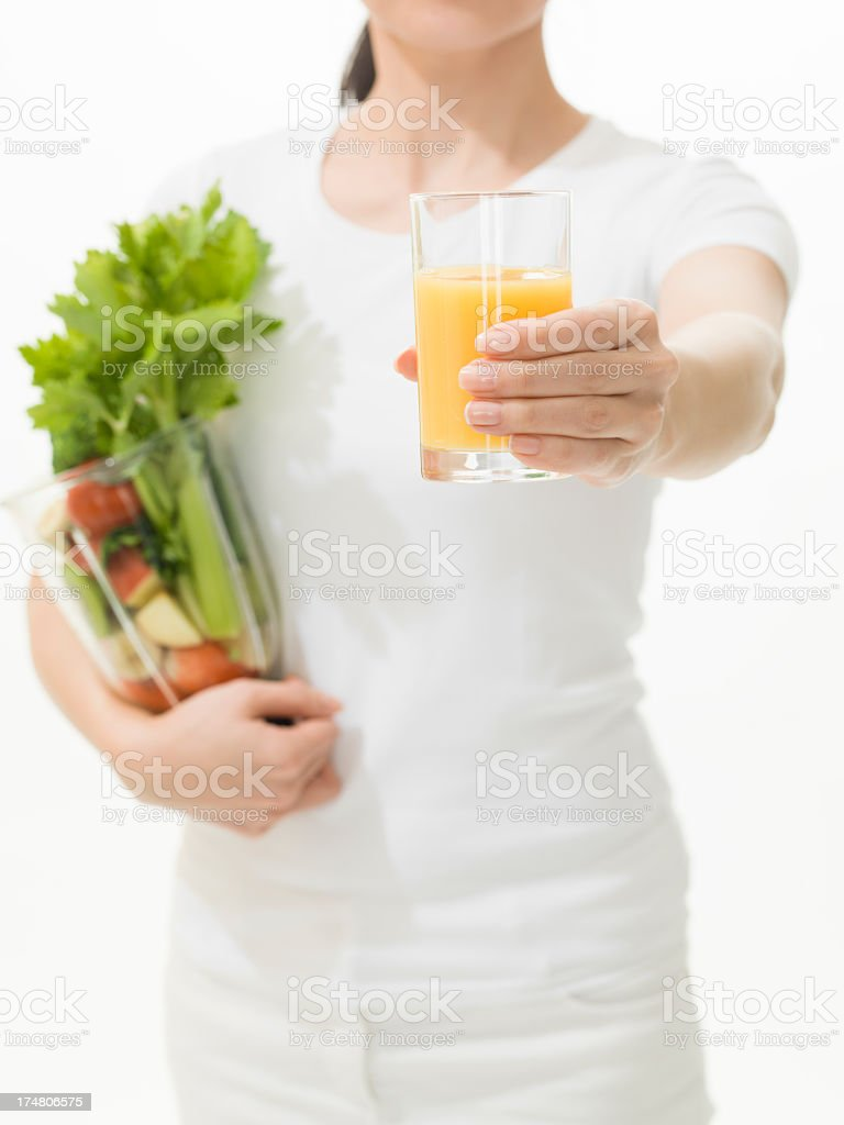 Woman holding Orange juice and Vegetable juicer stock photo