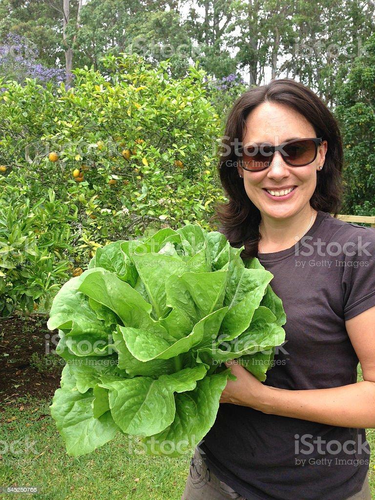 Woman holding organic lettuce stock photo