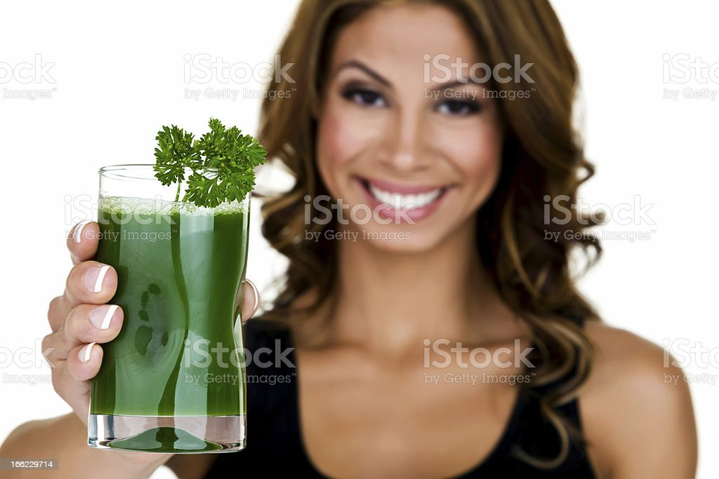 Woman holding out green juice royalty-free stock photo