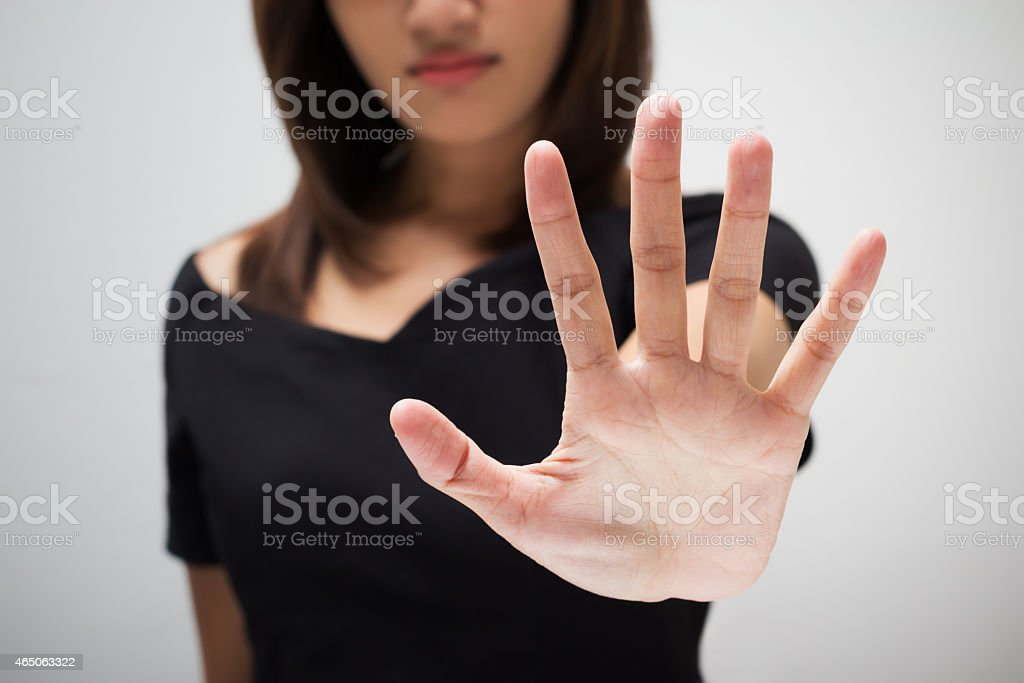 Woman holding out hand to signal no stock photo