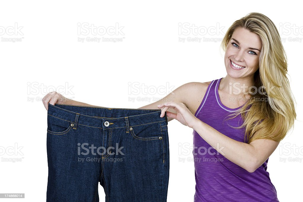 Woman holding oversized jeans royalty-free stock photo