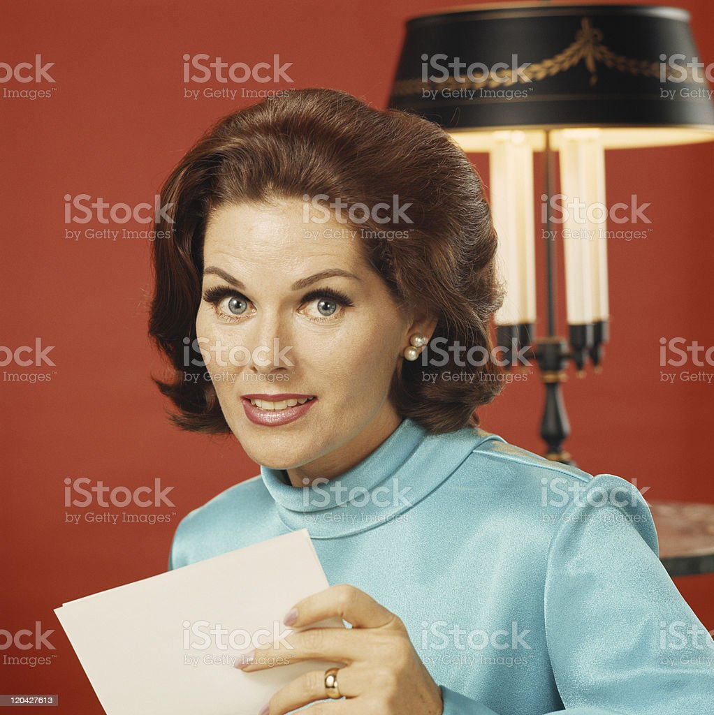 Woman holding paper, portrait, close-up royalty-free stock photo