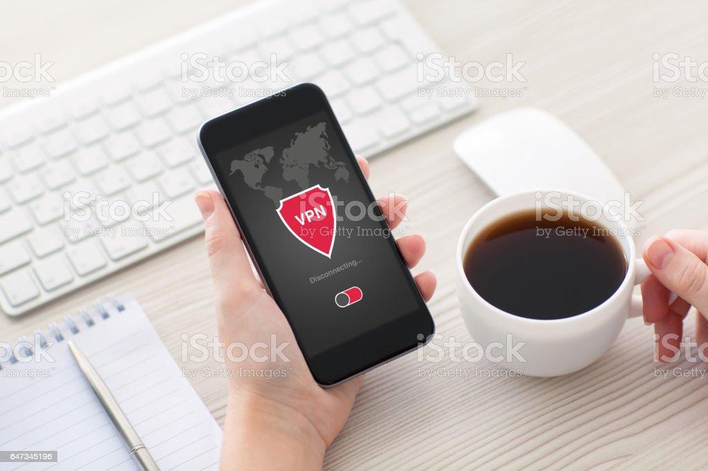 woman holding phone app vpn creation Internet protocols protection network stock photo