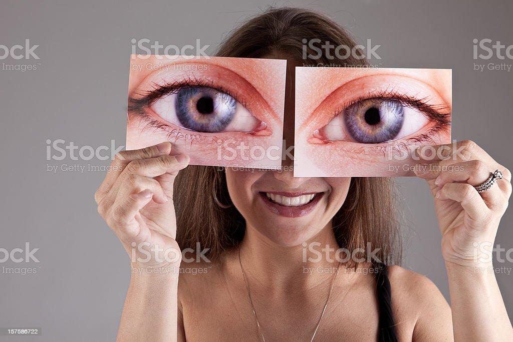 Woman Holding Photo of Eyes royalty-free stock photo