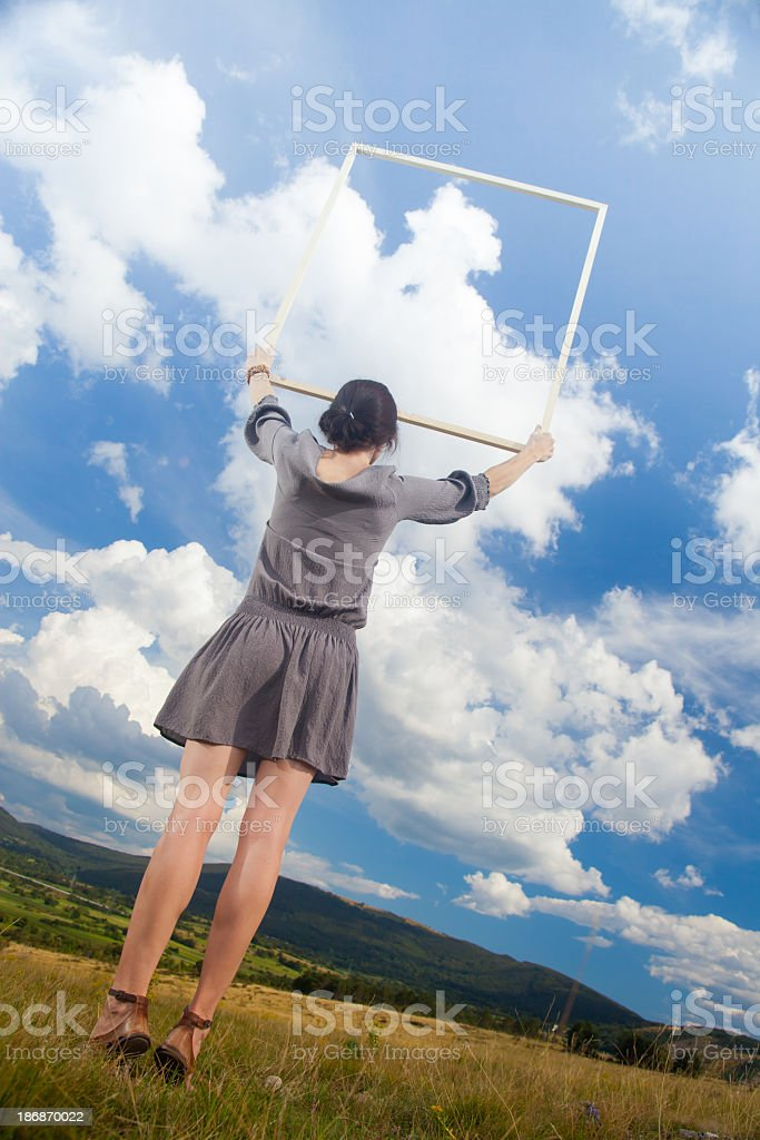 Woman holding picture frame royalty-free stock photo