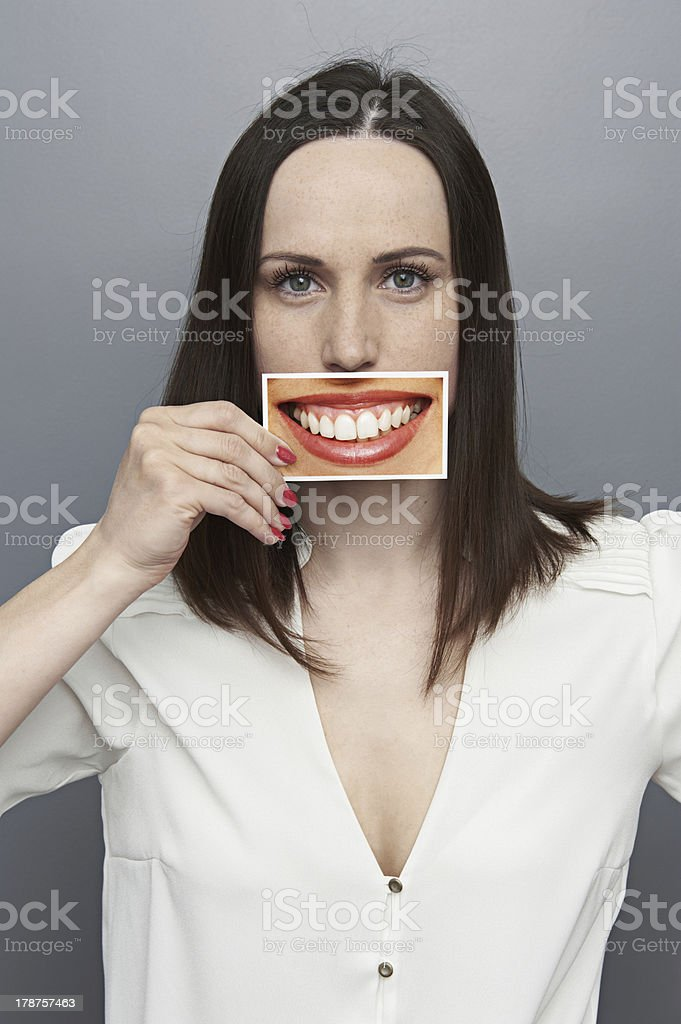 woman holding picture with big happy smile stock photo