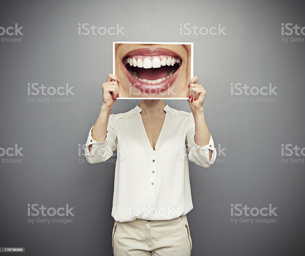 woman holding picture with big smile stock photo