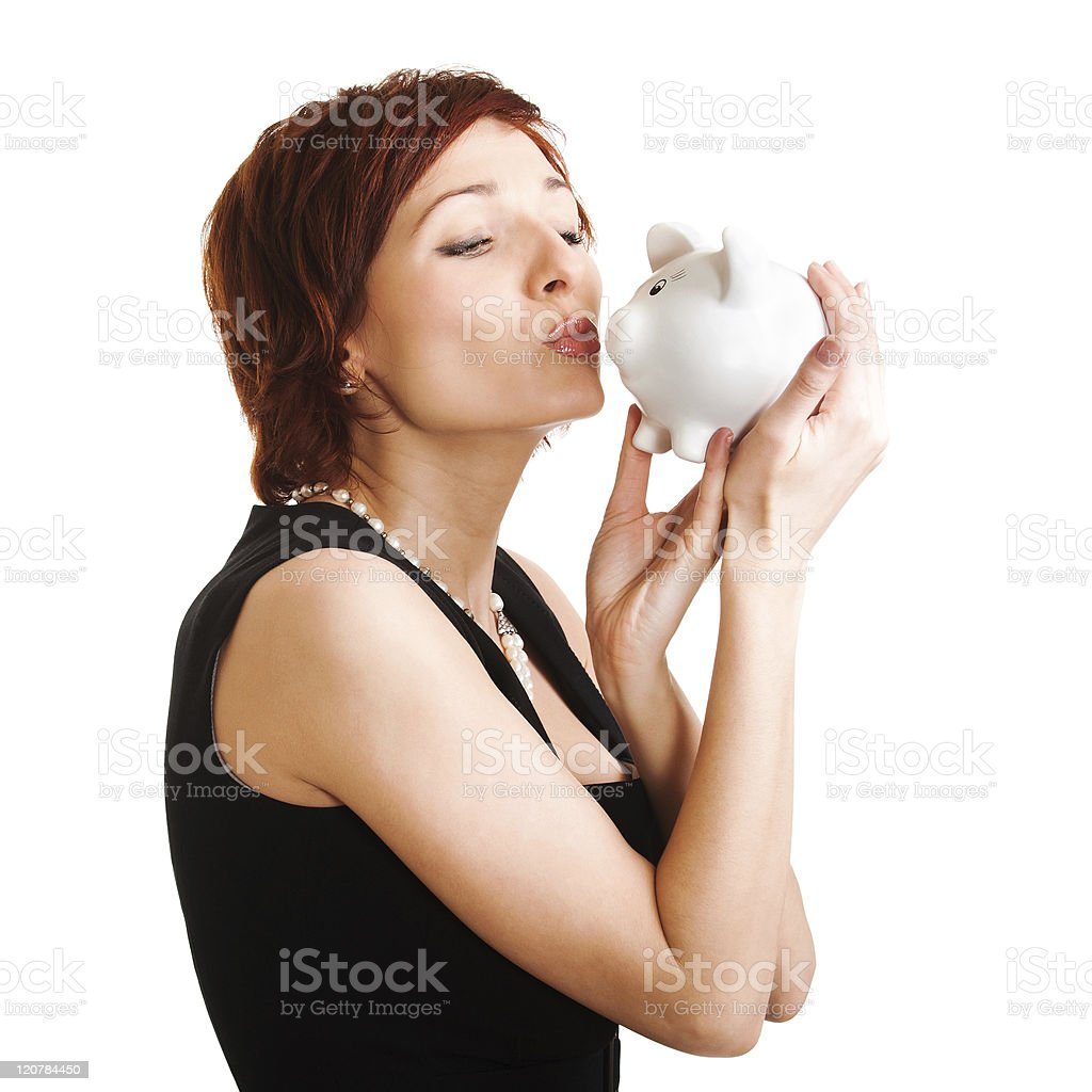 woman holding piggy bank against white background royalty-free stock photo