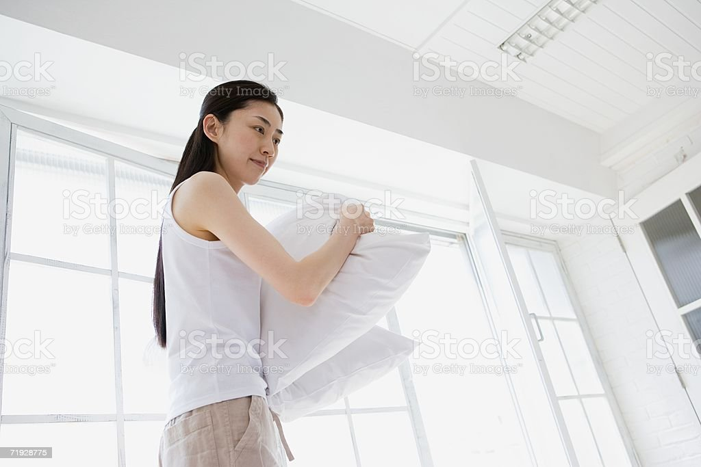 Woman holding pillows royalty-free stock photo