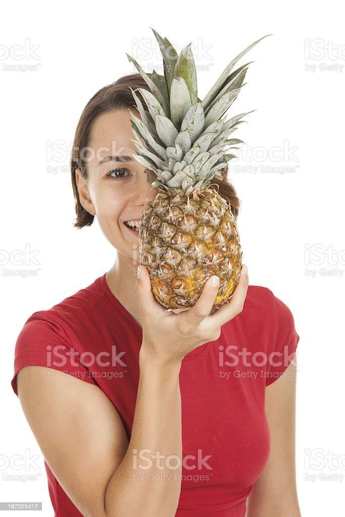 Woman holding pineapple stock photo