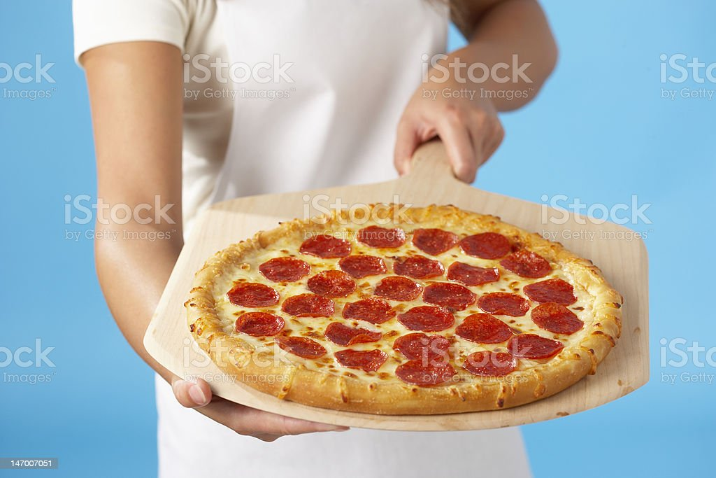 Woman holding Pizza stock photo