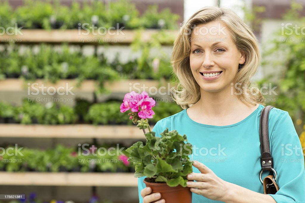 Woman Holding Potted Flower Plant royalty-free stock photo