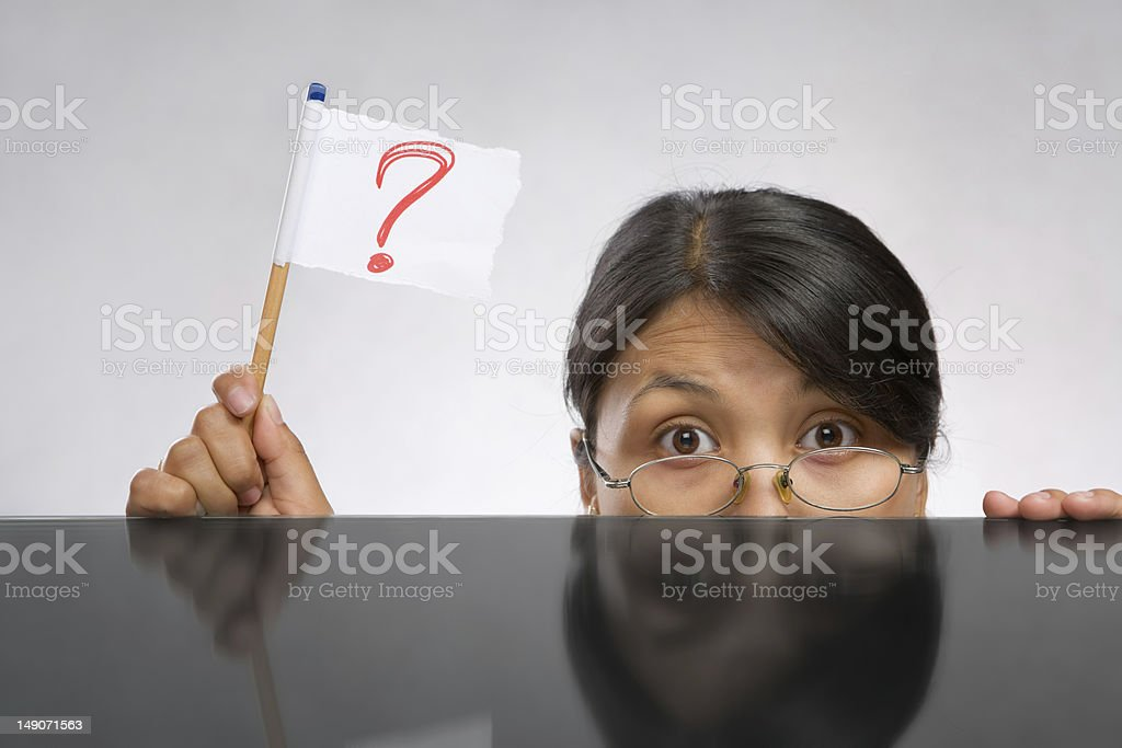 Woman holding question mark flag royalty-free stock photo