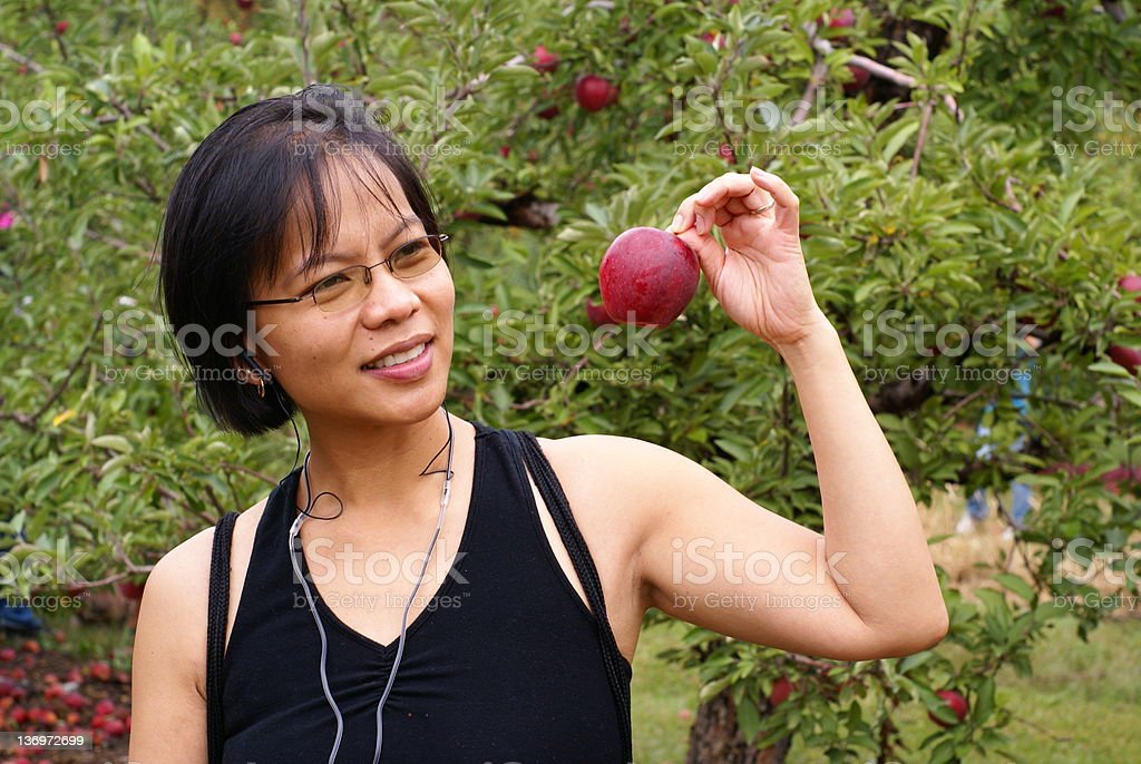 woman holding red apple royalty-free stock photo