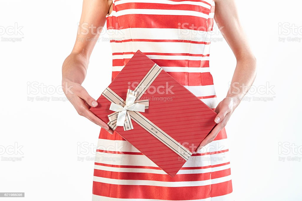 Woman holding red gift box stock photo