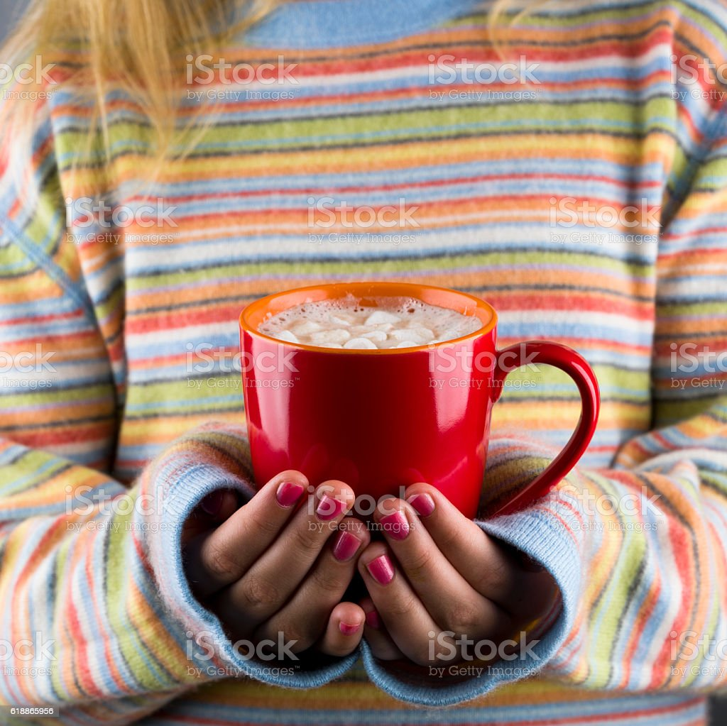 Woman Holding Red Mug with Hot Cocoa stock photo