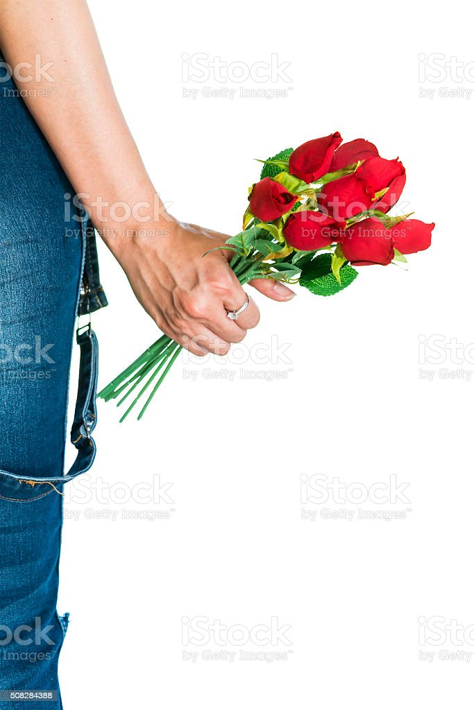 Woman holding red roses in her hand stock photo