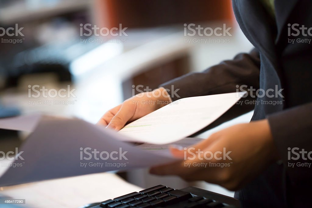 Woman holding report in the office stock photo