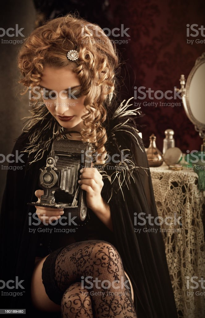 woman holding retro camera stock photo