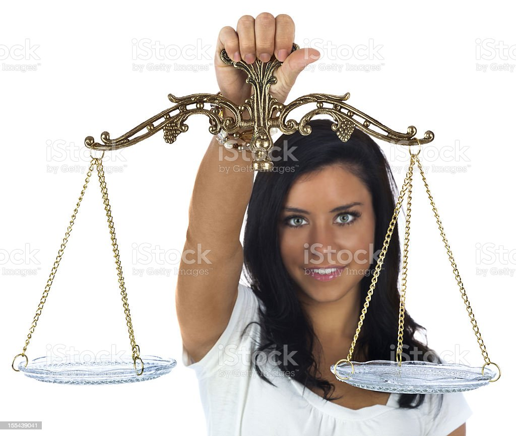 Woman Holding Scales of Justice royalty-free stock photo