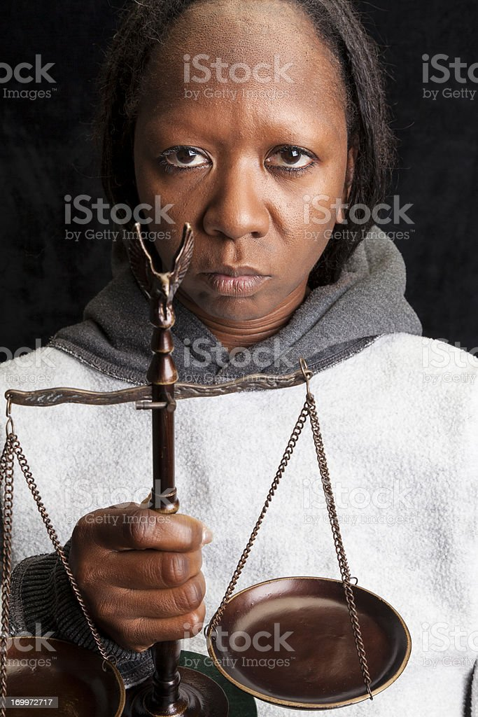 Woman Holding Scales of Justice stock photo