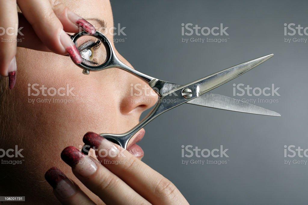Woman Holding Scissors royalty-free stock photo