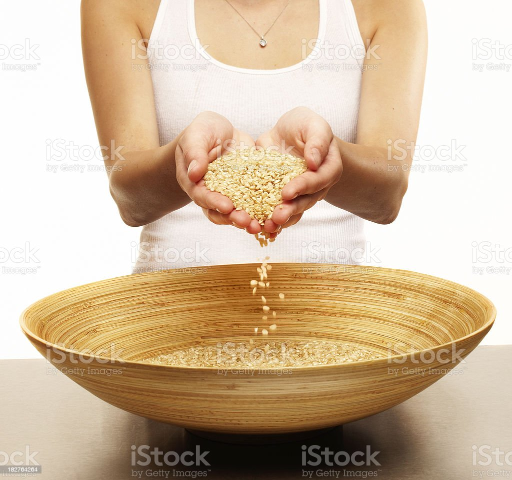 Woman Holding Seeds Over a Bowl. Isolated. royalty-free stock photo