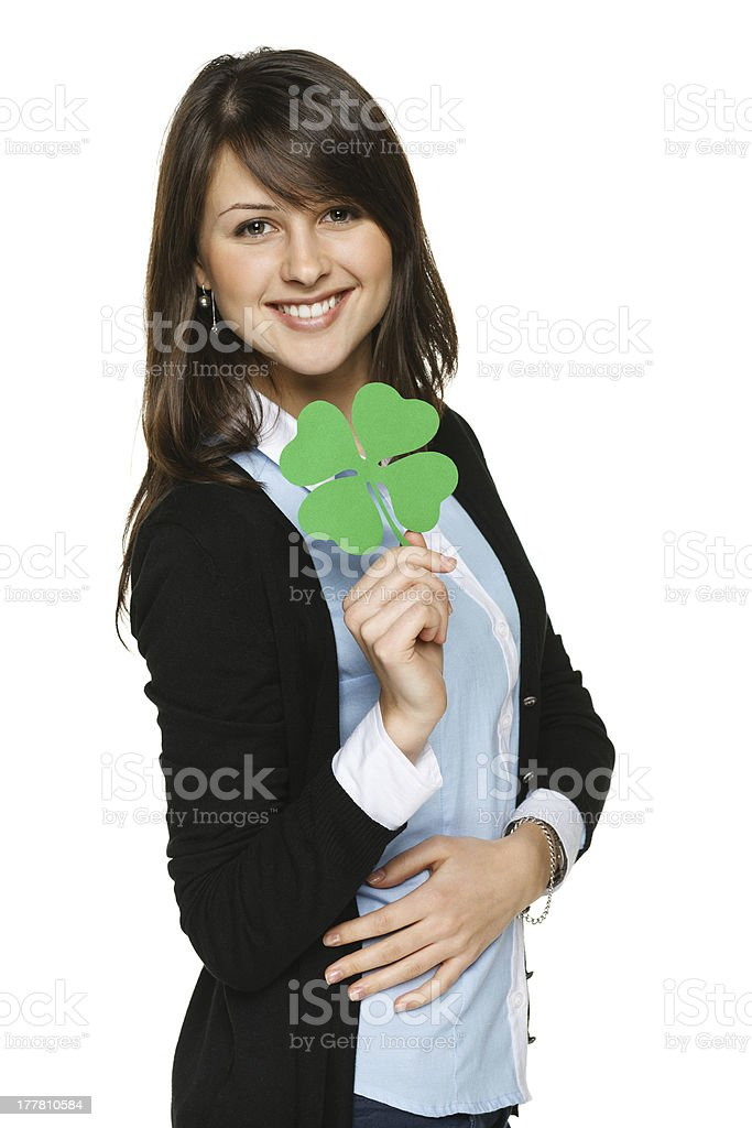 Woman holding shamrock leaf royalty-free stock photo